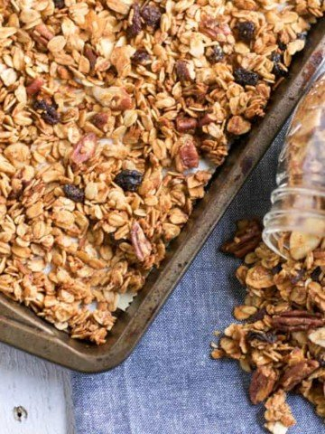 Maple Cinnamon Granola. Sweet maple and a touch of cinnamon make this crunchy granola perfect as a topping or all by itself! #granola #oats #maple #maplecinnamon #pecans #snacking #healthysnacking #cinnamon #maple
