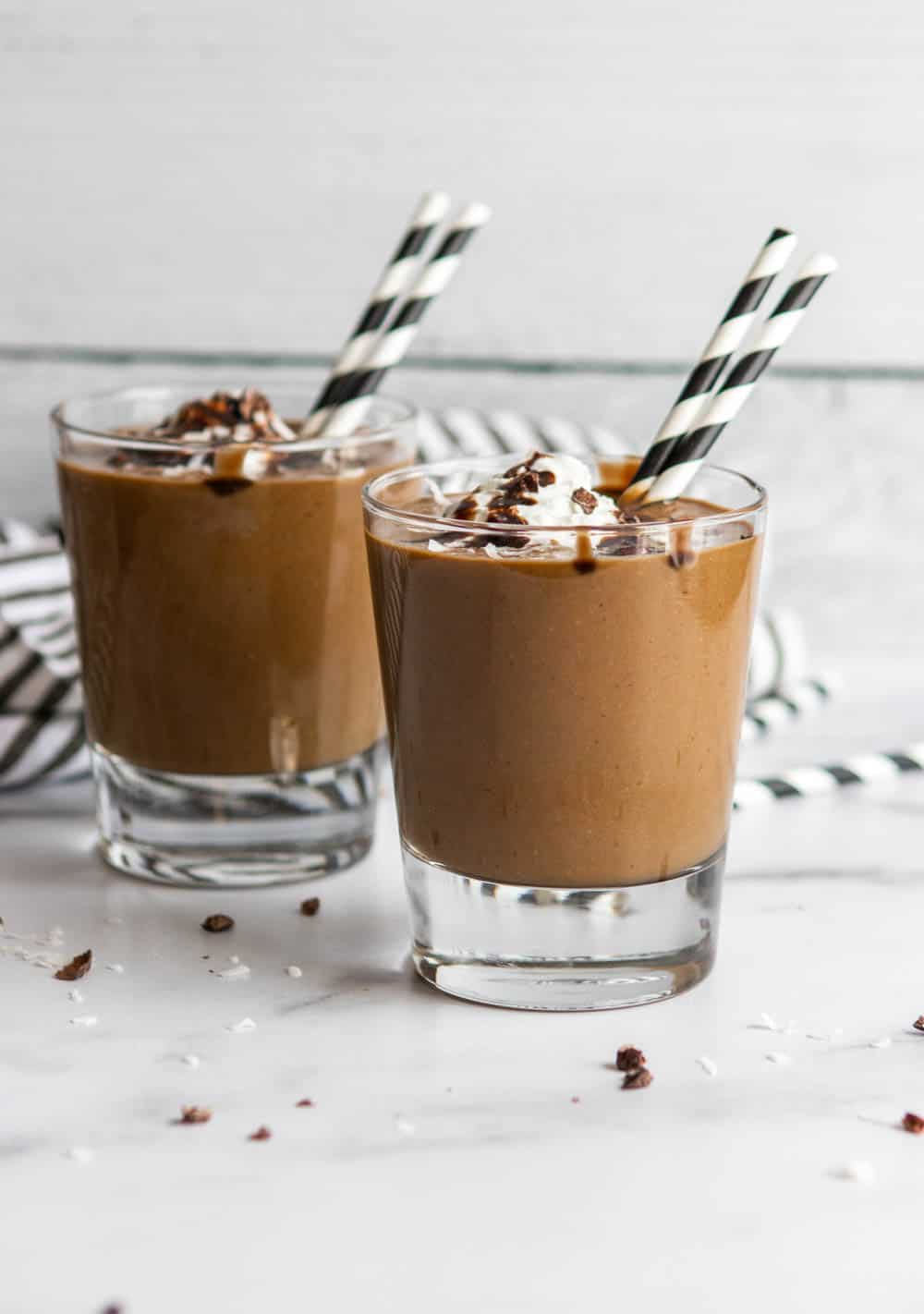 almond joy smoothies with whipped cream and chocolate sauce.