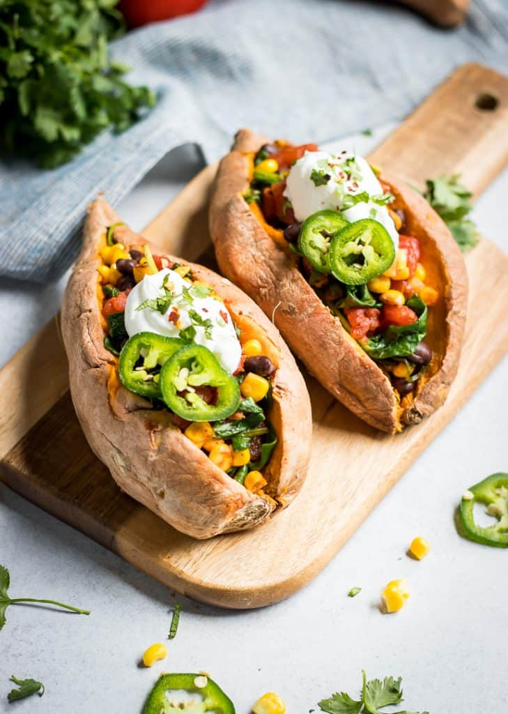 Take your sweet potatoes to the next level. These simple Mexican Stuffed Sweet Potatoes are an easy weeknight meal that is full of beans and veggies!