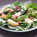 Roasted pears on salad with pomegranate arils.