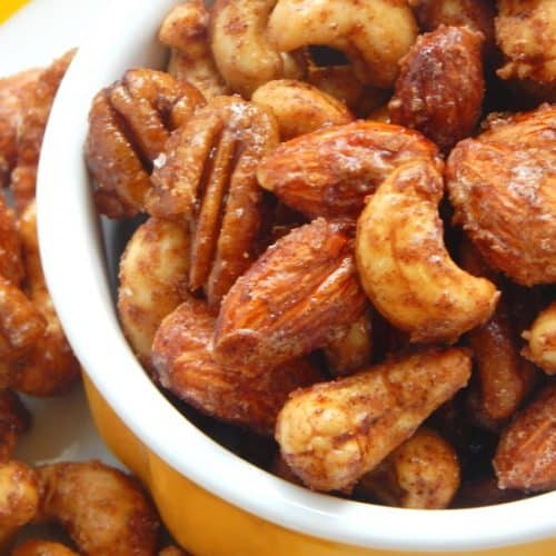 Mixed maple candied nuts in yellow bowl.