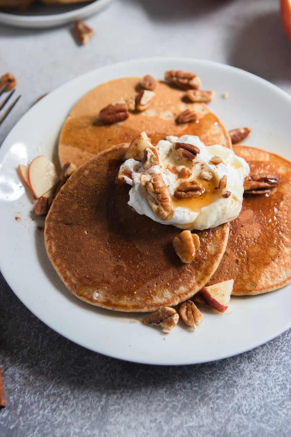 Apple Oatmeal Pancakes with maple, pecans and yogurt.