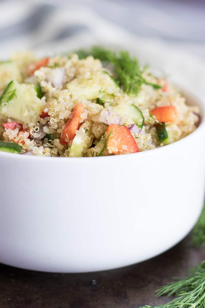 Cucumber Dill Quinoa Salad. This fresh and flavorful salad combines fresh dill with hearty quinoa, cucumber and red pepper. Tossed with olive oil and fresh garlic for the perfect salad for any occasion. #salad #summersalad #dill #cucumberdill #recipe #quinoa #quinoasalad