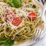 Avocado pesto pasta with fork.