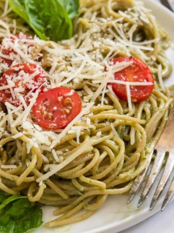 Avocado pesto pasta with fork.