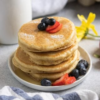 Stack of dairy free pancakes with berries.