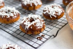 Whole Wheat Greek Yogurt Baked Whole Wheat donuts with a rich chocolate glaze, Greek Yogurt and your favorite donut toppings! Breakfast fun for everyone! #breakfast #chocolate