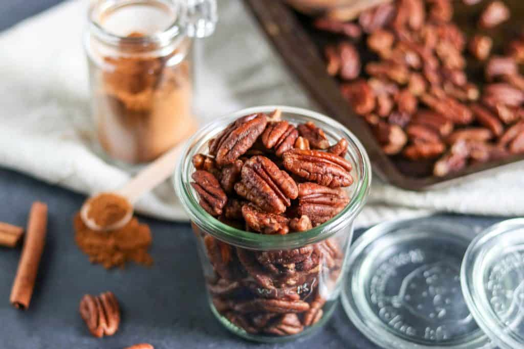 Maple Vanilla Spiced Pecans. Simple sweet pecans with a dusting of cinnamon and hints of vanilla. These are the perfect treat or addition to any fall recipe. They also make perfect gifts! lemonsandzest.com