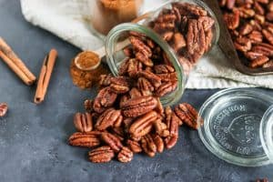Maple Vanilla Spiced Pecans. Simple sweet pecans with a dusting of cinnamon and hints of vanilla. These are the erfect treat or addition to any fall recipe. They also make perfect gifts! lemonsandzest.com