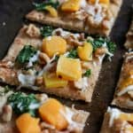 Walnut, Kale + Butternut Squash Naan Pizza. Don't settle for delivery. This simple dinner is ready in minutes and with only 5 minutes of prep. The whole family will love it! bewholebeyou.com