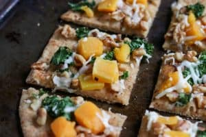 Walnut, Kale + Butternut Squash Naan Pizza. Don't settle for delivery. This simple dinner is ready in minutes and with only 5 minutes of prep. The whole family will love it! lemonsandzest.com