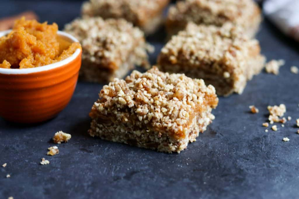 No Bake Pumpkin Crumble Bars. These simple no bake bars will be your new favorite treat! A handful of wholesome ingredients including almonds, pecans, medjool dates and cinnamon along with everyone's fall favorite: pumpkin! They will be ready in minutes! lemonsandzest.com