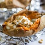 Stuffed and Smothered Breakfast Sweet Potatoes. Change up your typical breakfast with these stuffed sweet potatoes filled with bananas, chia seeds, cinnamon and so much more goodness! bewholebeyou.com