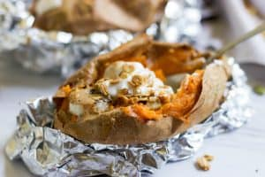 Stuffed and Smothered Breakfast Sweet Potatoes. Change up your typical breakfast with these stuffed sweet potatoes filled with bananas, chia seeds, cinnamon and so much more goodness! lemonsandzest.com