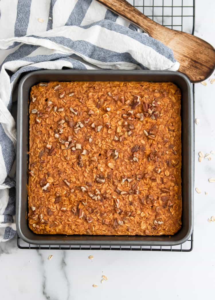 Pumpkin Baked Oatmeal in baking pan with pecans.