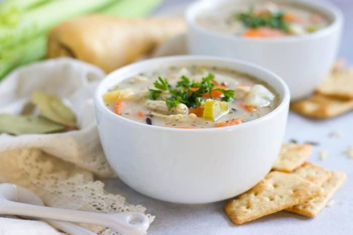 Slow Cooker Creamy Chicken and Wild Rice Soup. Chunks of carrots, celery and parsnips with savory spices and juicy chicken. This creamy soup is comfort food at it's finest during the cold seasons.