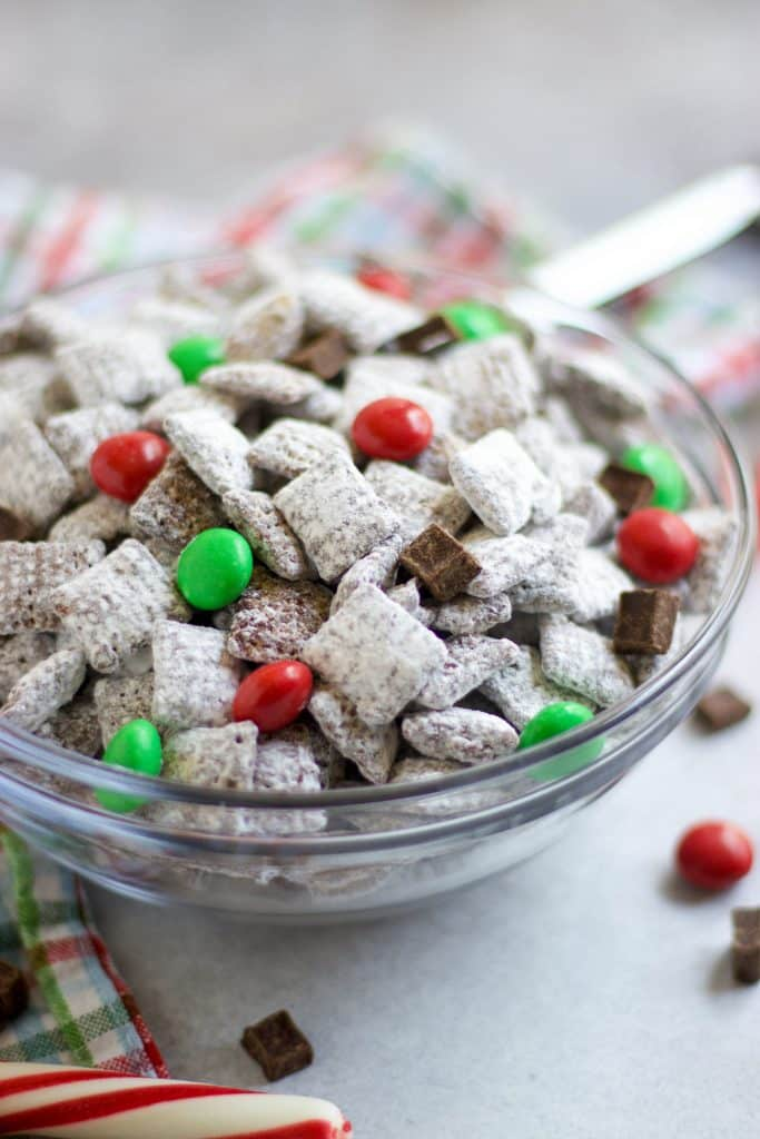 Christmas Puppy Chow with Chocolate chunks, red and green M&Ms.