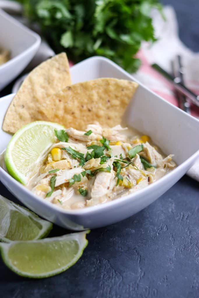 Slow Cooker Siracha Lime White Chicken Chili. Add a little spice to dinner with this simple hearty recipe. Packed with chicken, beans, a hint of lime and plenty of spice.