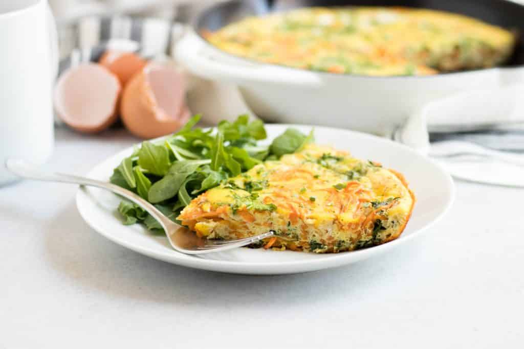 Spiralized Sweet Potato Baby Arugula Frittata. Farm fresh eggs, packed with veggies and freshly grated Parmesan cheese. Breakfast will be at its best. #fritatta #breakfast #spiralizer
