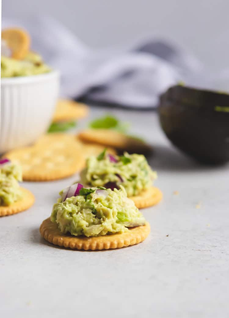 Avocado tuna salad on crackers.