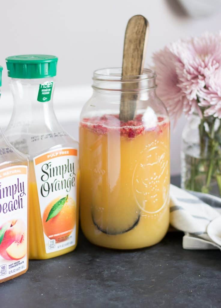 Ginger Orange Punch with Muddled Raspberries. This Mother's Day, make it a #SimpleMothersDay with Simply Orange Juice in this refreshing punch including Simply Peach Juice drink. #simplyorange #fruitpunch #refreshing #mothersday #simplerecipe