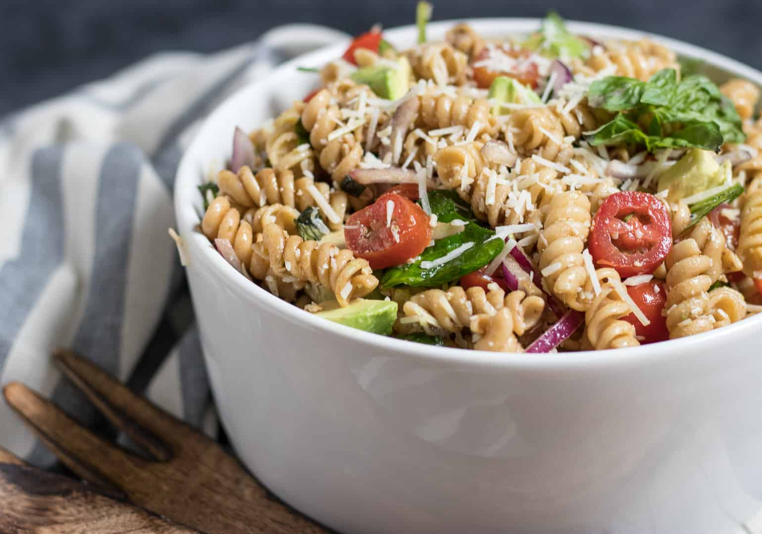 Tomato Basil Pasta Salad in white bowl