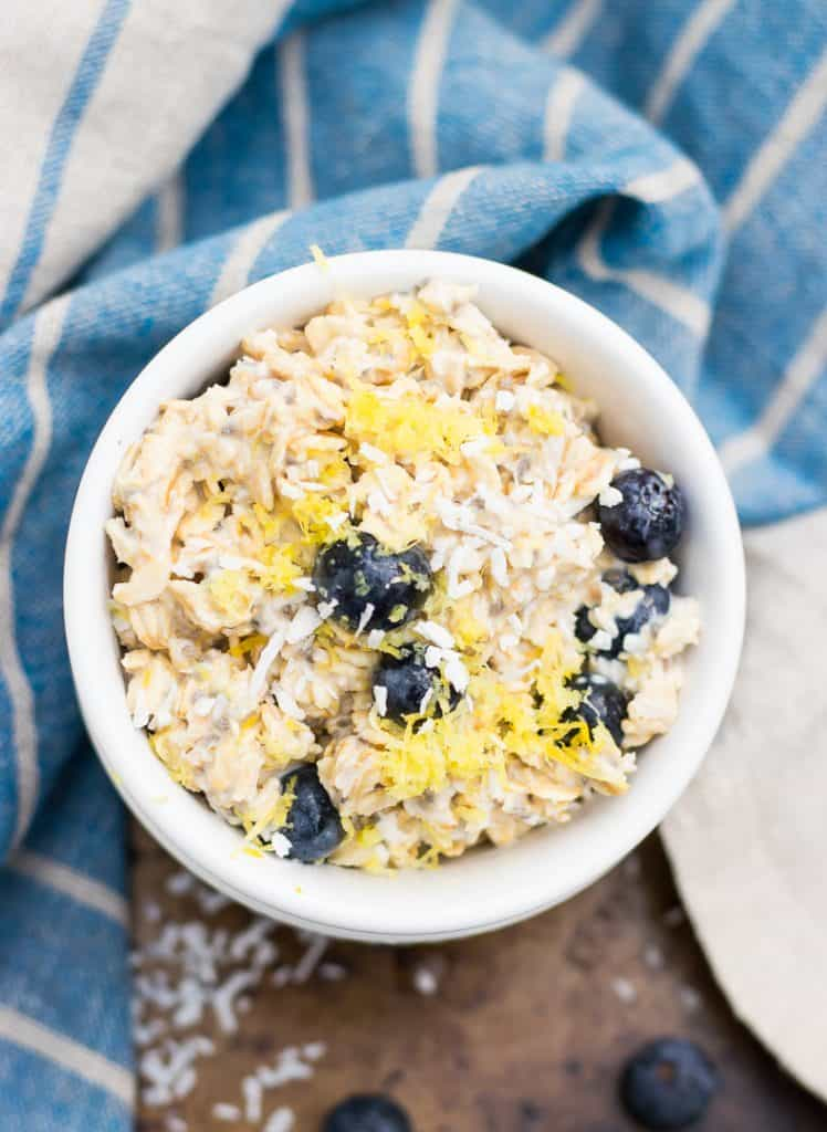 This Blueberry Lemon Coconut Overnight Oats recipe is so easy and ready in the morning for you! Chia seeds, almond milk, fresh blueberries and more are a healthy way to start your morning. Can be made vegan as well!