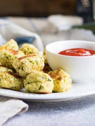 These Cheesy Zucchini Tots are a fun way to get the family to eat some veggies with a smile! They are simple to whip up and perfect for dipping into your favorite sauce!