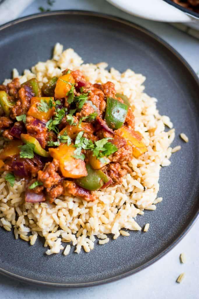Plate of ground turkey skillet recipe over rice.