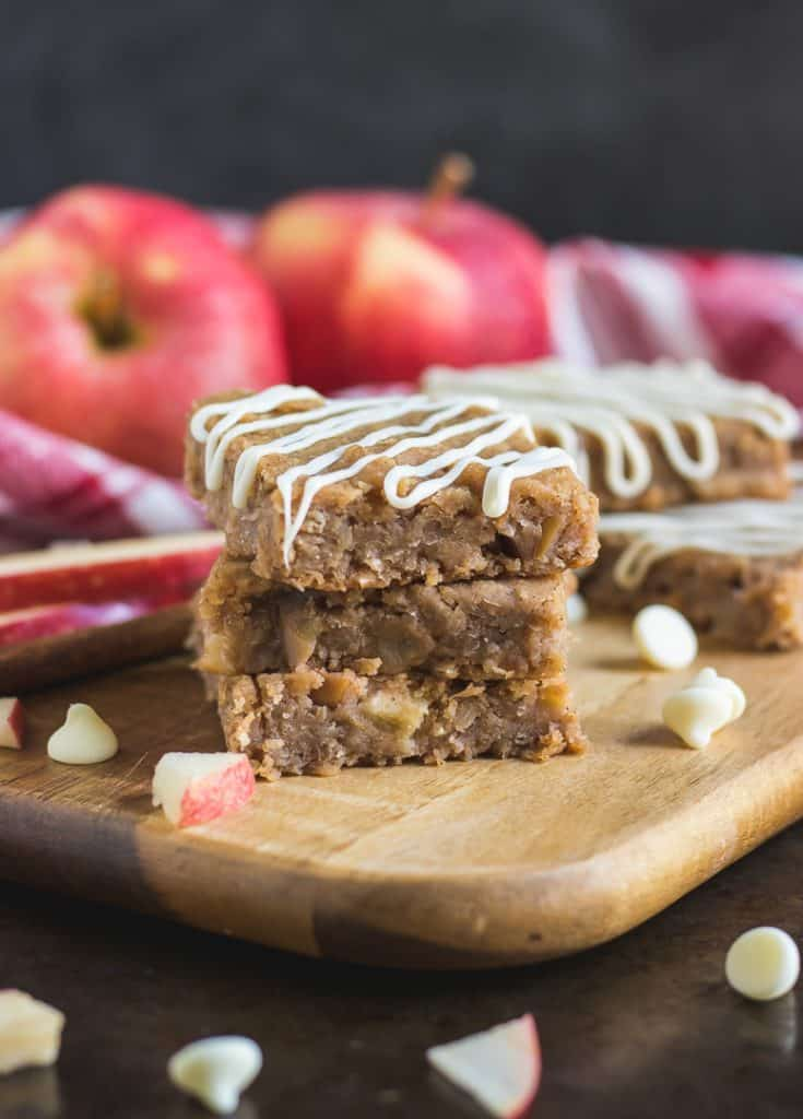 Packed with protein, these White Bean Apple Pie Bars are the perfect fall recipe to share! Rich and moist, baked goodness with white beans, apples, oats and a white chocolate drizzle, these will be a hit for any occasion this season!