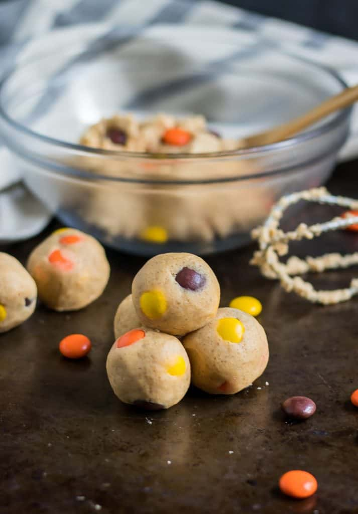 Have your cookie dough and eat it too! Egg-less, edible cookie dough that is! These Peanut Butter Reese's Pieces Cookie Dough Bites are a simple way to add a fun sweet treat this Halloween or any other time of the year when you are craving all things peanut butter! #cookiedough #peanutbuttercookiedough #reeses #reesespieces #nobake #halloween #simplerecipe