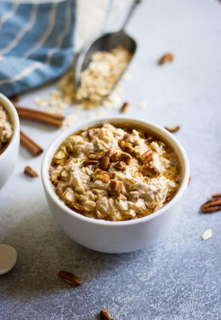 Cheesecake for breakfast? Yes please! This rich and creamy Maple Pecan Cheesecake Overnight Oatmeal recipe is so simple to make but will surely make waking up to breakfast quite the treat!