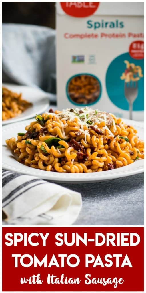 This Spicy Sun Dried Tomato Pasta served with Italian Sausage is a simple dinner recipe packed with protein and flavor! Use Sun-dried Tomatoes and spices to make to whip up a quick and flavorful sauce the whole family will love! #ad #moderntablemeals #spicy #pasta #moderntable #lentilpasta #sundriedtomato #italian #italiansausage #dinnerrecipe