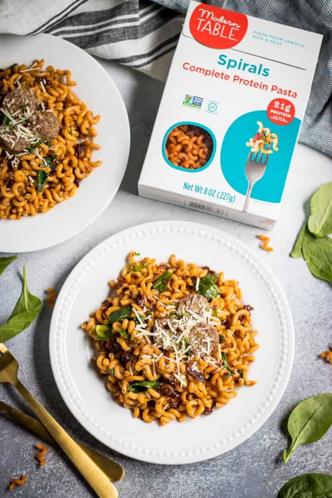 This Spicy Sun Dried Tomato Pasta served with Italian Sausage is a simple dinner recipe packed with protein and flavor! Use Sun-dried Tomatoes and spices to make to whip up a quick and flavorful sauce the whole family will love!