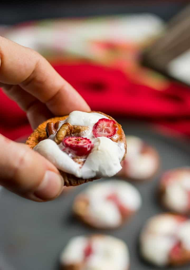 Think sweet potato casserole in a simple bite sized appetizer. These Cranberry Pecan Sweet Potato Bites are topped with pecans, cranberries and gooey marshmallows for a delicious Thanksgiving or holiday recipe! #Thanksgiving #sweetpotato #appetizer #cranberry #holidayrecipe #sidedish