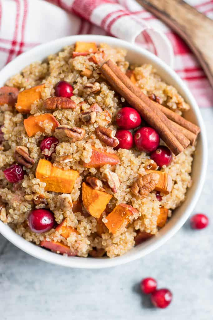 Not your typical Thanksgiving side, but this simple side dish recipe is sure to be a great addition this holiday. Roasted sweet potatoes, cranberries, crunchy pecans with a touch of maple and cinnamon. #cranberry #thanksgiving #quinoa #thanksgivingside #sidedish