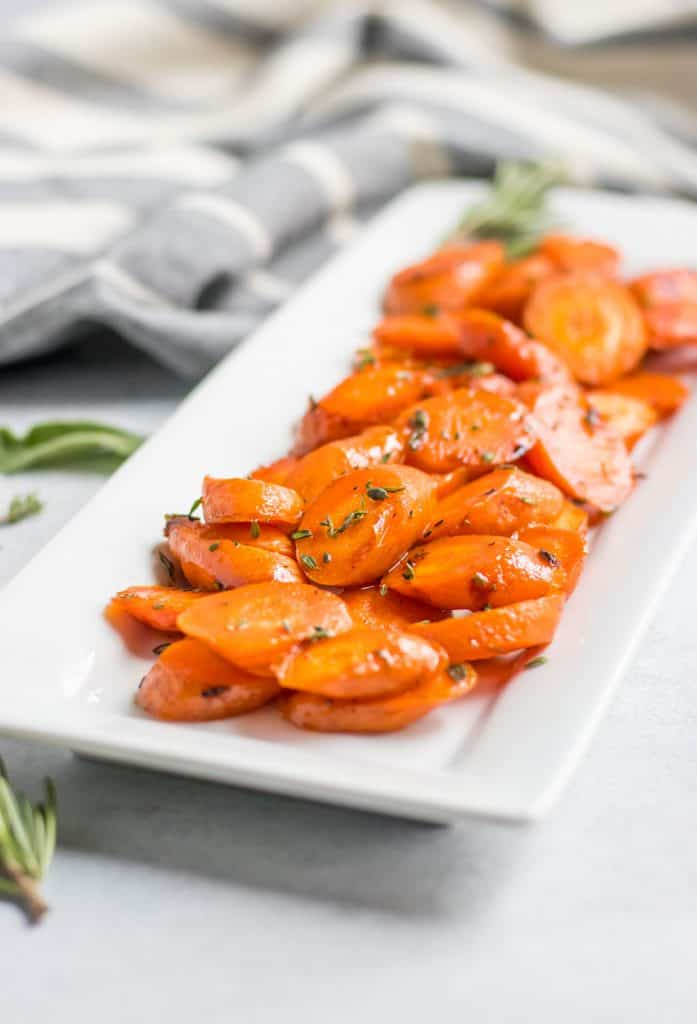 maple glazed carrots on white serving dish.