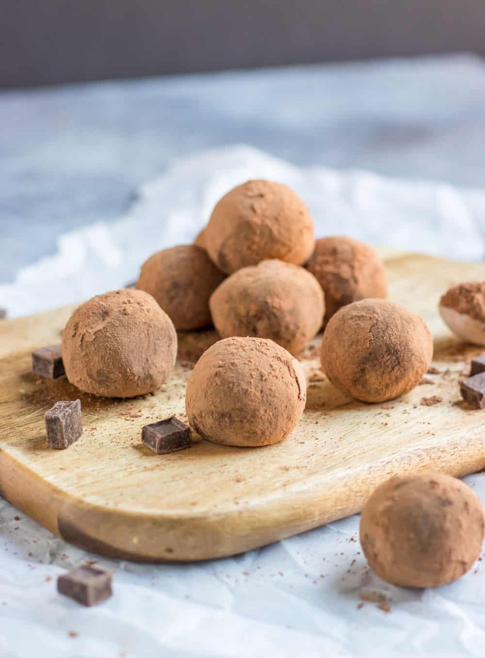 Cocoa dusted amaretto truffles on wood board