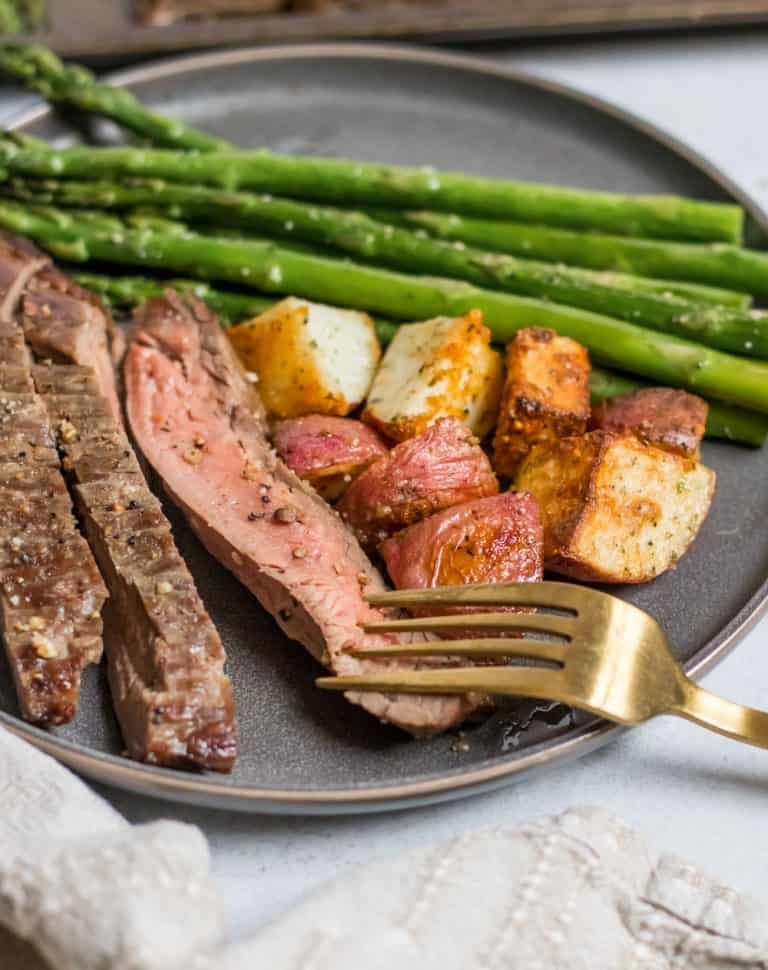 Parmesan Crusted Steak, potato, and asparagus sheet pan dinner
