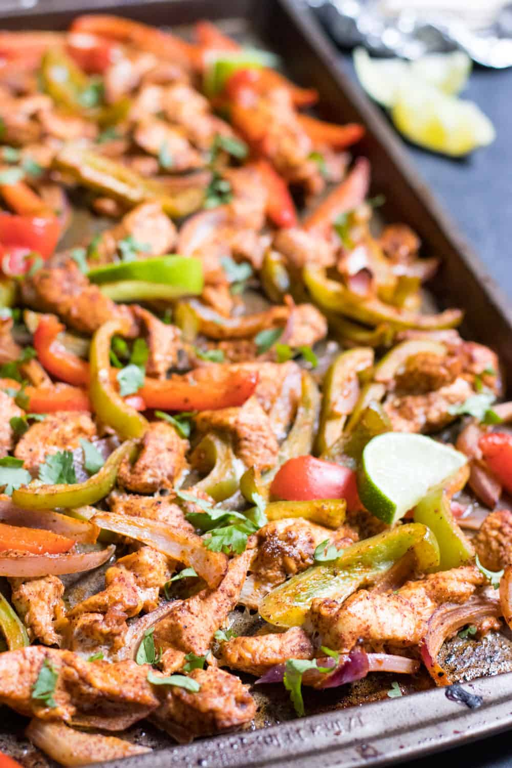 Sweet and Smoky Sheet Pan Chicken Fajitas with chicken, red and green peppers