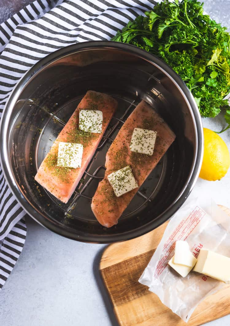 Butter on salmon in Instant Pot Pan.