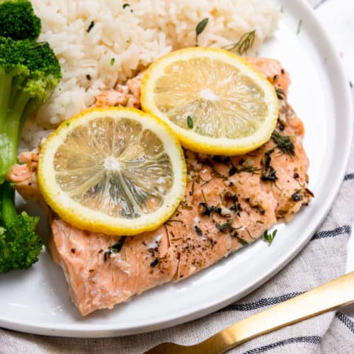 Instant Pot salmon on plate with rice and broccoli.