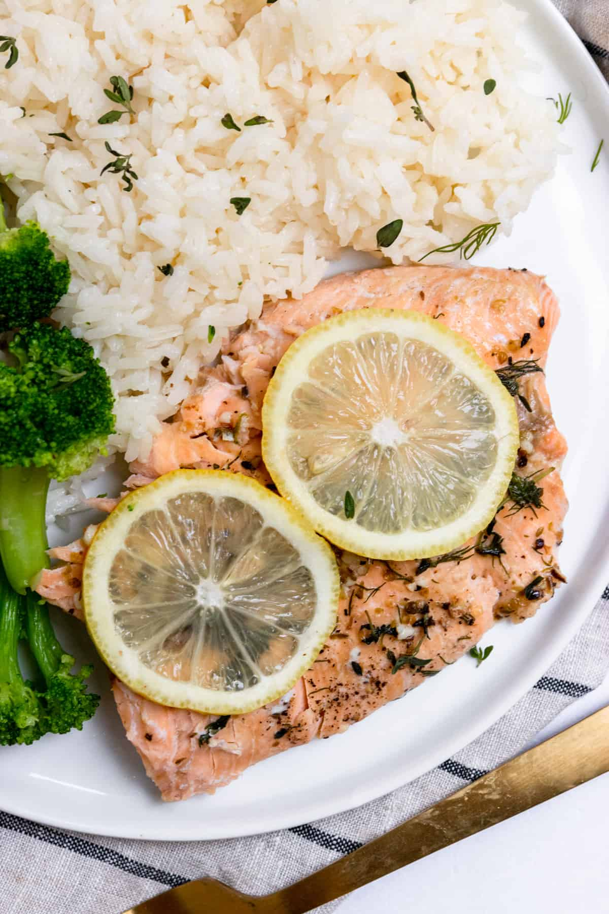 Overhead shot of salmon with rice and broccoli.
