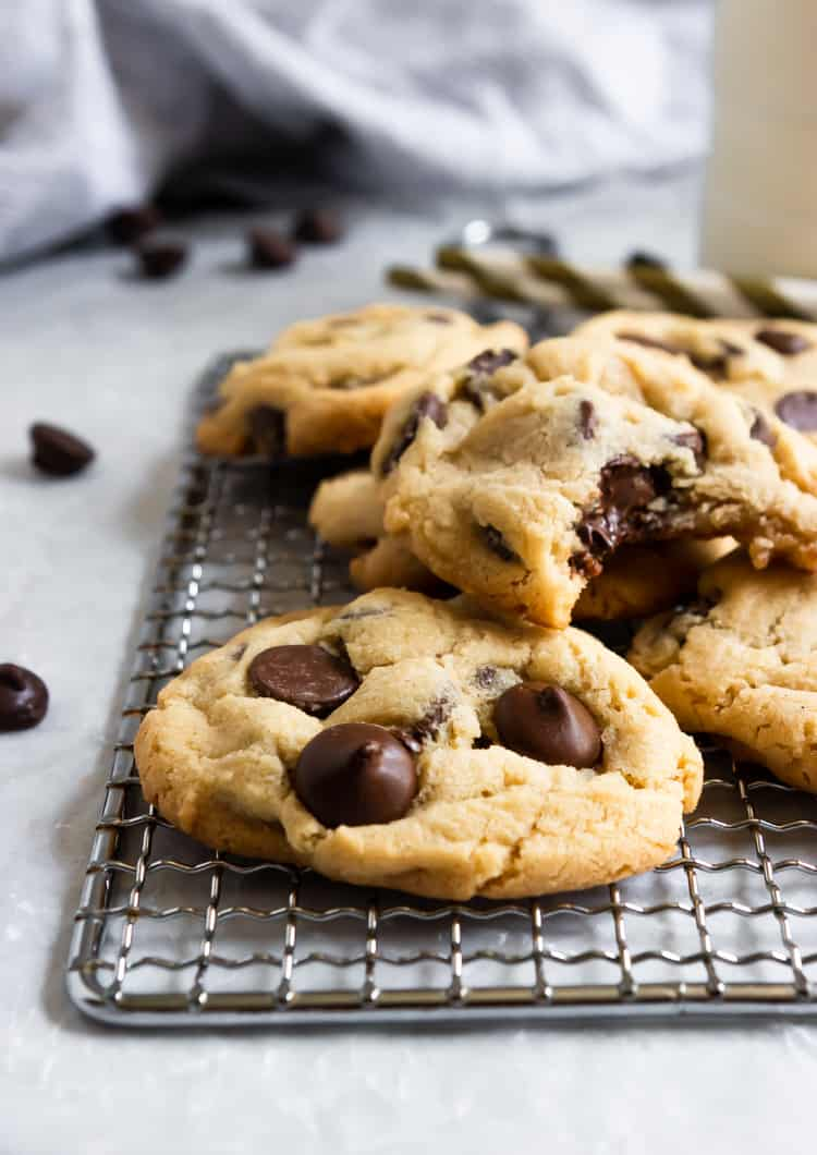 Chocolate Chip Cookies on cooling rack with a bite out of one cookie.