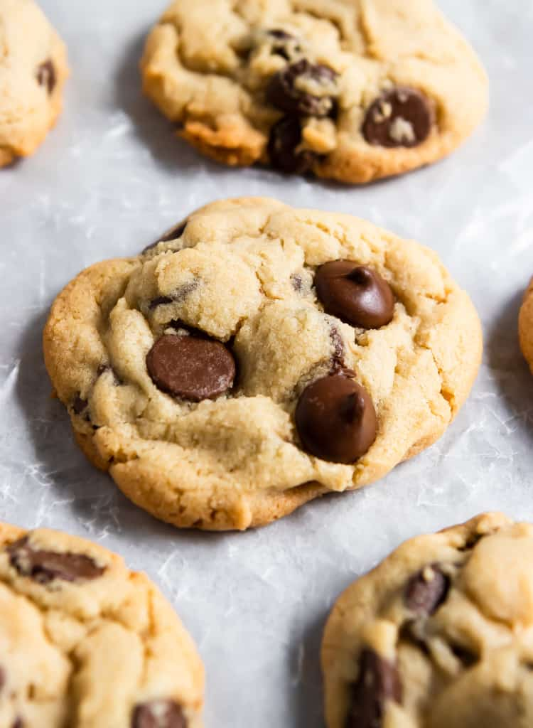 Chocolate chip cookies on parchment.