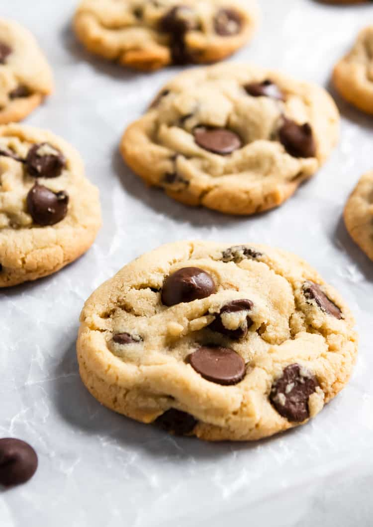 Chocolate Chip Cookies laying on parchment.