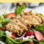 Strawberry goat cheese salad on plate with chicken.