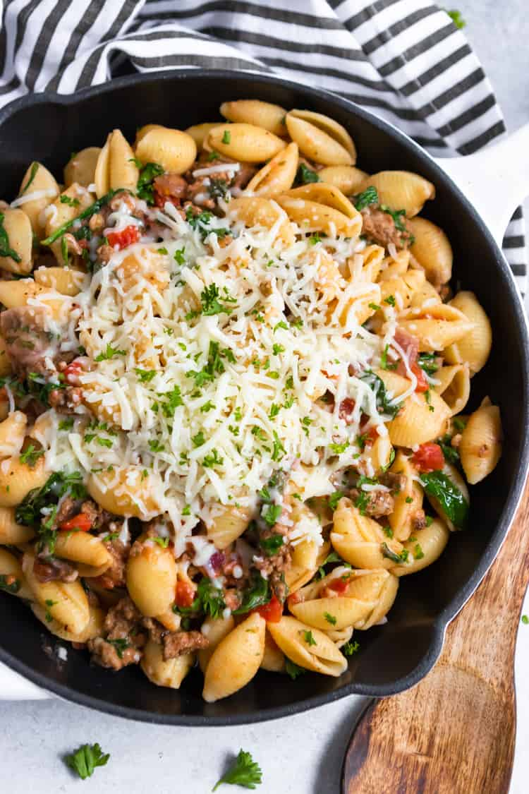Beef and shells skillet with shredded mozzarella.