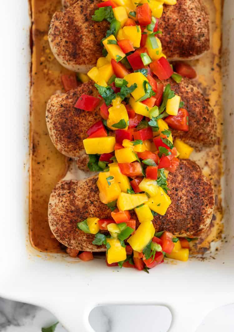 Chicken with Mango Salsa in white pan.