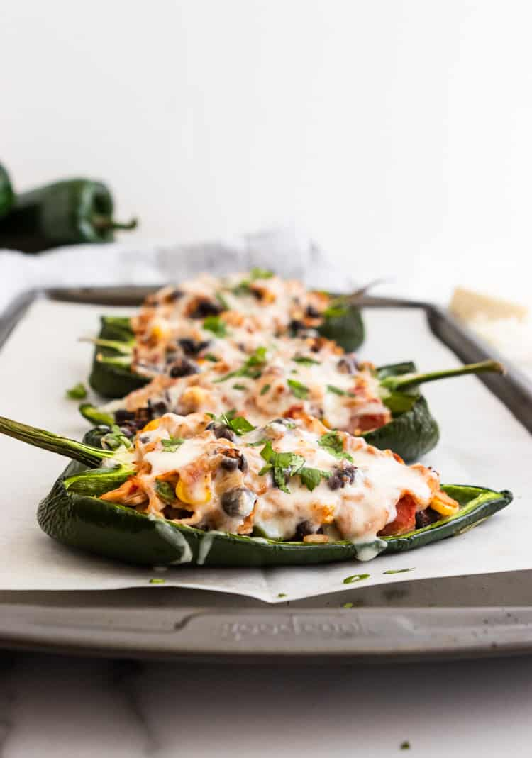 Chicken Stuffed Poblano Peppers on sheet pan with parchment.